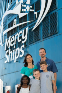Yangas family photo in front of the Africa Mercy.